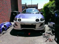 Front view of a Toyota Celica before painting