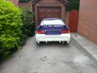 Rear view of a Toyota Celica before painting