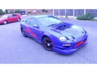 Front three quarter view of a Toyota Celica after painting