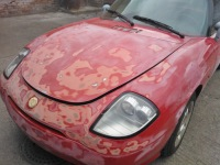 Fiat Barchetta bonnet with damage repaired