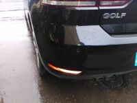 Close up of VW Golf rear bumper dent repaired and painted