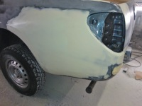 Rear nearside three quarter view of pickup prepared ready for painting